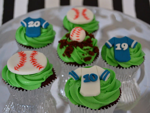 Blue Jays Baseball Cupcakes by Sugar Street Boutique Toronto. Toronto cupcakes. Chocolate cupcakes. Red velvet cupcakes. Toronto cupcake. sugar street boutique. lets go blue jays. baseball cupcakes. jays cupcakes. fan cupcakes. sports cupcakes. lets go blue jays cupcakes. ball cupcakes. josh donaldson 20 cupcake. donaldson cupcake. jose bautista 19 cupcake. bautista cupcake. jersey cupcake. baseball jersey cupcake. encarnation cupcake. edwin encarnacion 10 cupcake.