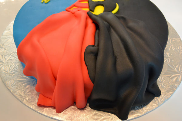 Batman & Superman cake by Sugar Street Boutique. Toronto cake. Lemon cake. lemon superhero cake. batman cake. superman cake. superhero cake. fondant cake. toronto baker. sugar street boutique. superheroes. superheroes cake. cape cake. superman. batman.