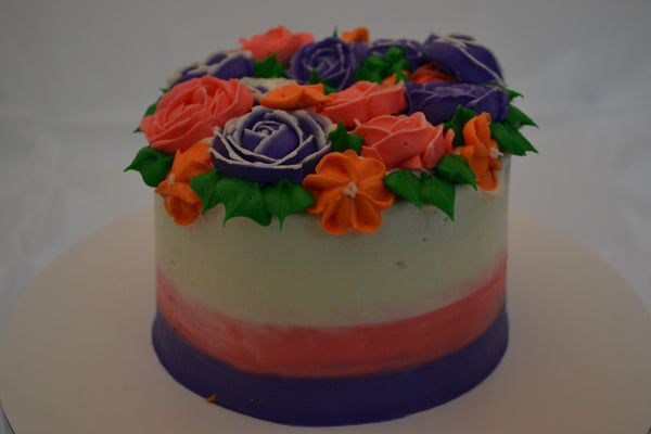 icing flower cake by sugar street boutique. sugar street boutique. icing flower cake. icing flower cake toronto. toronto cakes. lemon cake. lemon curd filling. lemon cream cheese icing. lemon flowers. cream cheese flowers. flowers cake. flowers cake toronto. designer cake. purple flowers cake. orange flowers cake. red flowers cake. colourful flower cake.