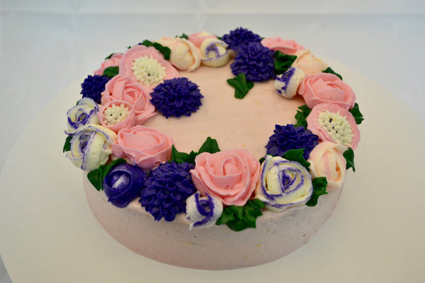 icing flower cake by sugar street boutique. sugar street boutique. icing flower cake. icing flower cake toronto. toronto cakes. lemon cake. lemon curd filling. lemon cream cheese icing. lemon flowers. cream cheese flowers. flowers cake. flowers cake toronto. designer cake. purple flowers cake.  colourful flower cake. light pink flowers icing. pink and purple icing flowers. piping flowers.  icing flowers cake toronto.