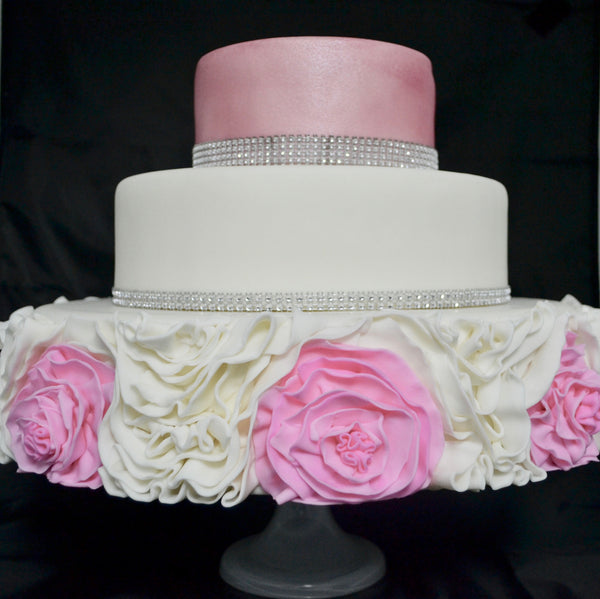 wedding rose cake by sugar street boutique. sugar street boutique toronto. wedding cake. wedding cake toronto. pink and white wedding cake. pink roses wedding cake. pink roses fondant. pink and white wedding 3 tier cake. three tier wedding cake toronto. ruffle rose cake. ruffle rose cake toronto. bling wedding cake. bling rose cake. wedding fondant cake.