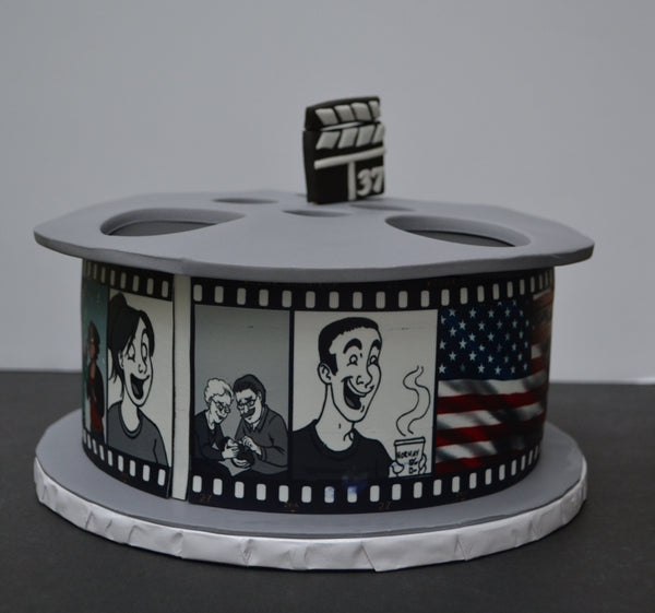 This Vanilla Movie Reel Cake was 100% edible. Decorated with edible images and fondant by Sugar Street Boutique Toronto