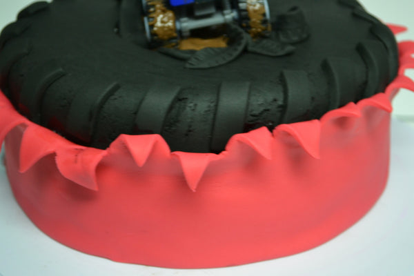 monster truck red velvet cake with a big tire by sugar street boutique toronto
