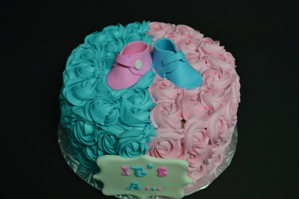 Vanilla Gender reveal baby cake with pink and blue rosettes and pink or blue smarties in the centre to reveal the gender of the baby by Sugar Street Boutique Toronto.