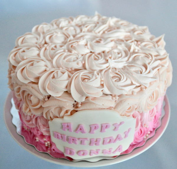pink ombre rosette carrot cake with cream cheese icing by Sugar Street Boutique Toronto