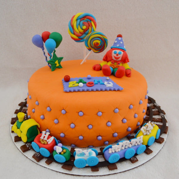 Gymboree Cake by Sugar Street Boutique Toronto Ontario Canada Gymbo the Clown Gymboree Play & Learn Chocolate Cake HappyCake Circus Cake Train Cake Fondant Masterpiece Colourful Cake Balloons Lollipops Luxury Cakes