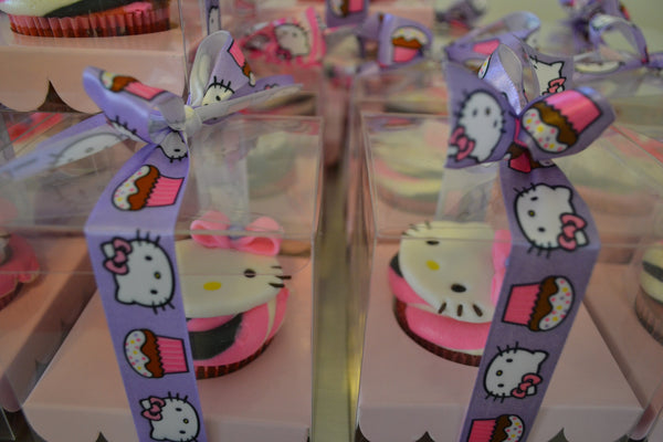 Hello Kitty Cupcakes by Sugar Street Boutique Toronto Ontario Canada Vanilla Cake HappyCake Fondant Masterpiece Colourful CupCake Luxury CupCakes Kitty Cake Cupcake in a box Hello Kitty Ribbon Boxed Cupcake TriColour Swirl Birthday Giveaways