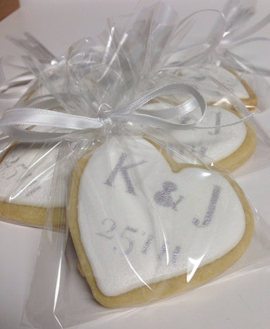 25th Anniversary cookies by Sugar Street Boutique Toronto. 25th Anniversary. 25th Anniversary cookies. Anniversary cookies. cookies. decorated cookies. party cookies. loot bag cookies. shortbread. shortbread cookies. party cookies. cookies giveaway. cookies toronto. shortbread cookies toronto. individually wrapped cookies. white icing cookies. white icing silver writing cookies.
