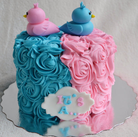 Gender reveal cake by Sugar Street Boutique Toronto. Toronto cake. Toronto cakes. gender reveal. gender reveal cake. pink or blue cake. boy or girl cake. bird cake. rosette cake. pink and blue rosettes. lemon cream cheese. lemon cake. designer cake.