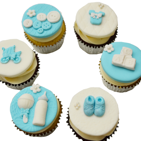 blue and white baby shower cupcakes toronto by sugar street boutique with fondant baby booties, fondant baby rattle,  fondant baby bottle, fondant buttons, fondant onesie, fondant baby cubes & fondant stroller