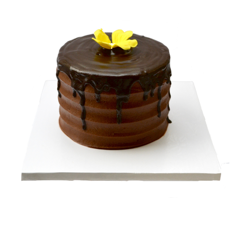 Chocolate drip cake decorated with an edible yellow flower by sugar street boutique, toronto cakes