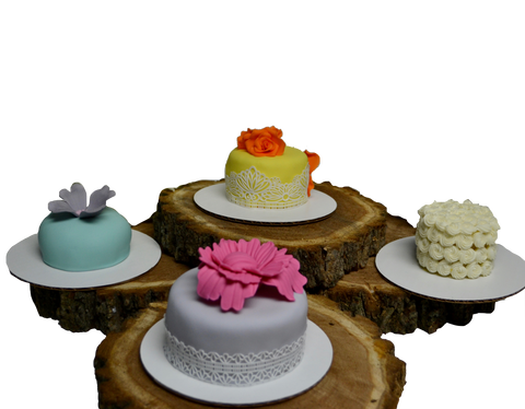 Mini cakes, individually sized, red velvet mini cake, chocolate mini cake, lemon mini cake and vanilla mini cake decorated with edible flowers, small icing rosettes with spring colours by Sugar Street Boutique