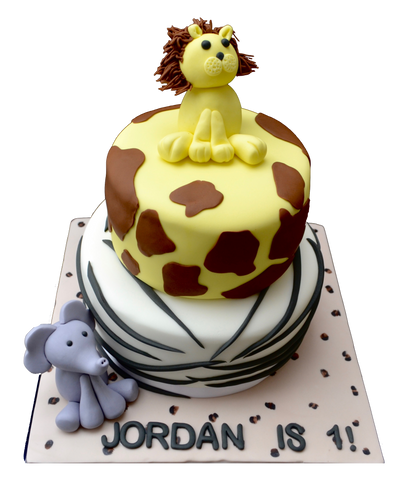 Animal print chocolate & lemon cake with an edible elephant & lion. sugar street boutique. toronto cakes. edible lion. edible elephant, giraffe animal print cake, zebra animal print cake.
