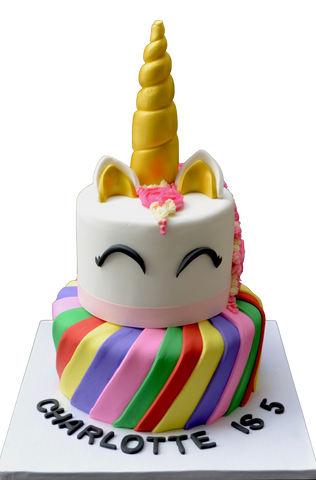 2 tier unicorn cake with rainbow bottom tier with nutella chocolate cake and top tier unicorn pink made of chocolate chip cookie dough cake by Sugar Street Boutique Toronto Cakes. colourful cake