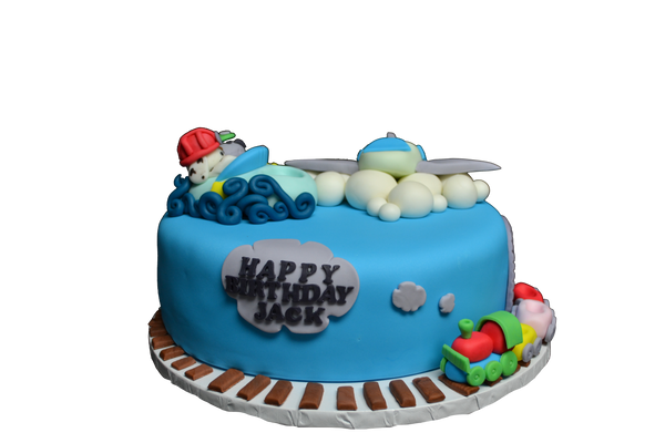 A fully loaded cake with a plane, boat and a train with Marshall & Rocky from Paw Patrol by sugar street boutique