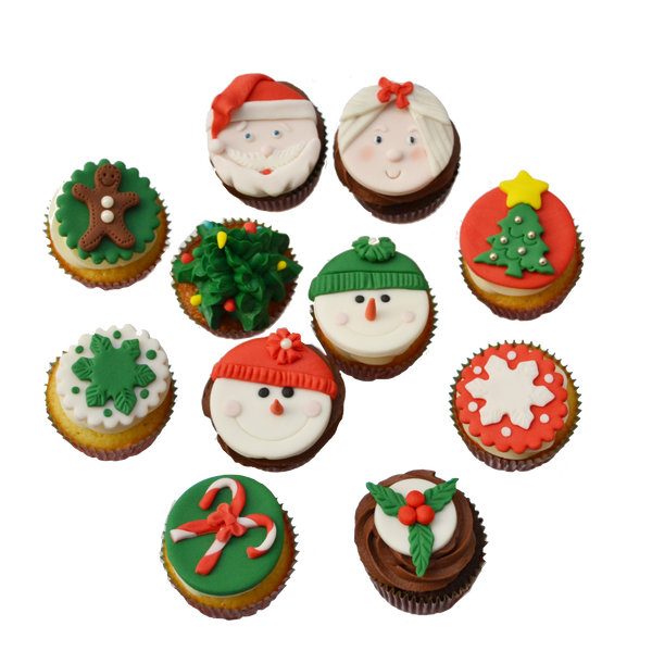 Christmas cupcakes toronto with snowman cupcakes toppers, christmas tree cupcake toppers, ms.claus and santa cupcakes toppers, gingerbread man cupcakes topper and a snowflake cupcake topper by sugar street boutique toronto