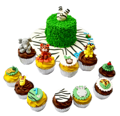 zebra into the cake cake, with animal cupcakes for a safari themed birthday sweets, cupcakes and cake with a lion cupcake, elephant cupcake, tiger cupcake, hippo cupcake by Sugar Street Boutique, toronto cakes