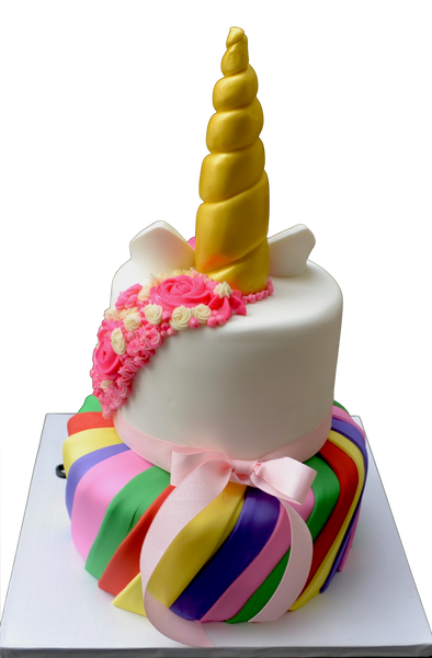 2 tier unicorn cake with rainbow bottom tier with nutella chocolate cake and top tier unicorn pink made of chocolate chip cookie dough cake by Sugar Street Boutique Toronto Cakes