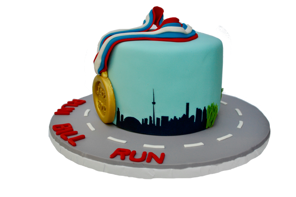 jazz run toronto marathon 2017 cake with a gold medal, the toronto skyline and a running man, run bill run. Vanilla cake with chocolate icing by sugar street boutique toronto.