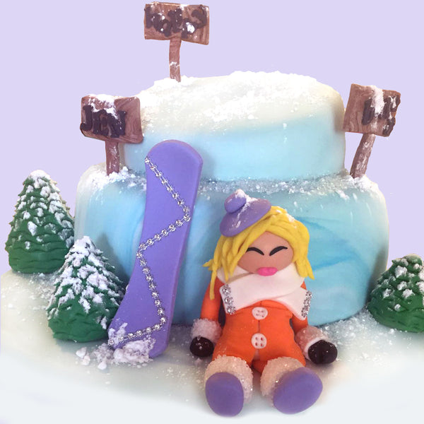 Snowboard Girl Fondant Cakes Designs by Sugar Street Boutique Toronto Canada snowboard snow blonde snowboarder lemon cake winter cake purple snowboard all edible