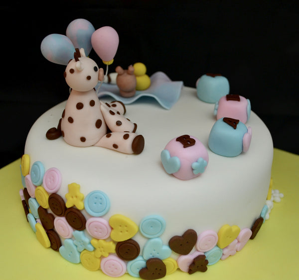 Baby Shower chocolate cake by Sugar Street Boutique decorated with fondant.