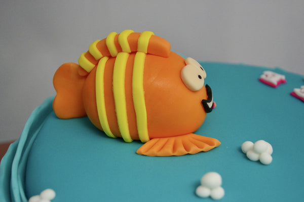 Bubble Guppies character Mr. Grouper chocolate cake covered with fondant and edible figurines by Sugar Street Boutique Toronto made for a birthday.