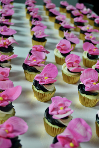 chocolate and lemon cupcakes with edible orchids by Sugar Street Boutique in Toronto.