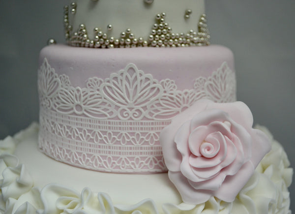 3 Tier Wedding Cake decorated with edible lace, silver pearls & ruffles, covered with fondant by Sugar Street Boutique Toronto. Fondant Rose.