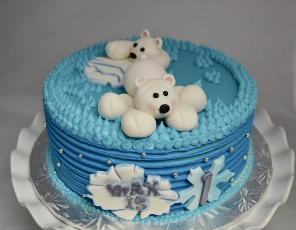 Vanilla Polar Bear Birthday Cake decorated with cream cheese icing and fondant polar bears by Sugar Street Boutique Toronto