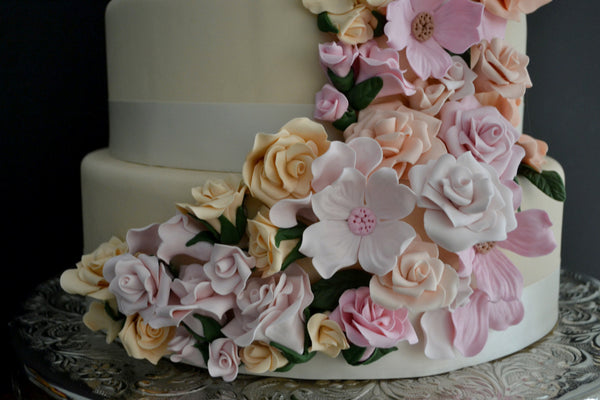 5 Tier Wedding Floral drapping Cake with soft pink and peach colors made by Sugar Street Boutique Toronto