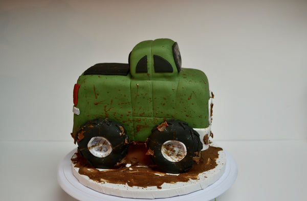 Chocolate pickup truck shaped cake covered with fondant and 100% edible by Sugar Street Boutique Toronto