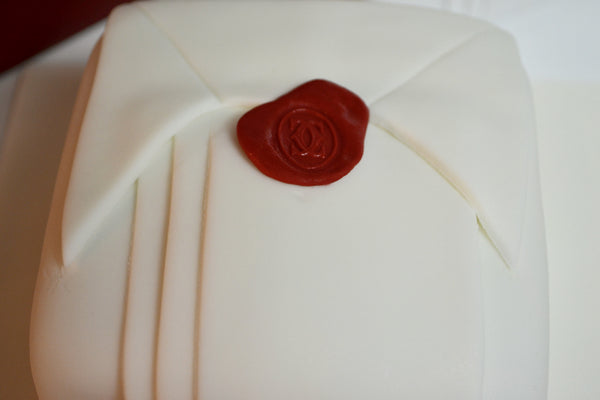 Cartier, red seal, white box chocolate cake covered in fondant made by Sugar Street Boutique, Toronto.