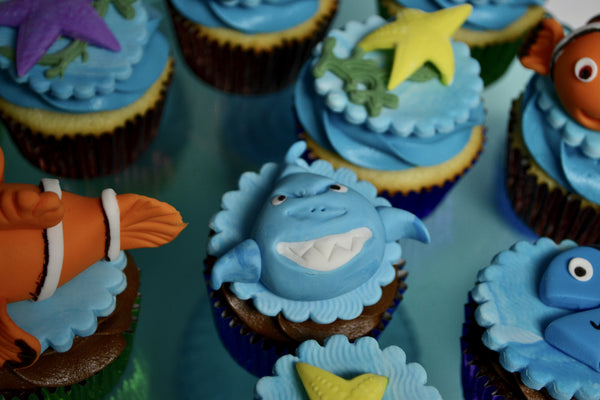 Nemo & Dory cupcakes with a sea theme, fondant turtle, fondant shark, fondant dory, fondant nemo, birthday cupcakes by sugar street boutique toronto
