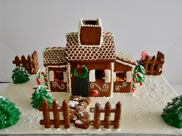 Gingerbread house with battery operated Christmas lights inside.  Decorate your home with this beautiful gingerbread house for Christmas and it is edible by Sugar Street Boutique Toronto. Gingerbread house toronto.