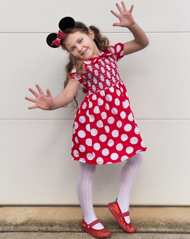 Girl dressed up as Minnie Mouse