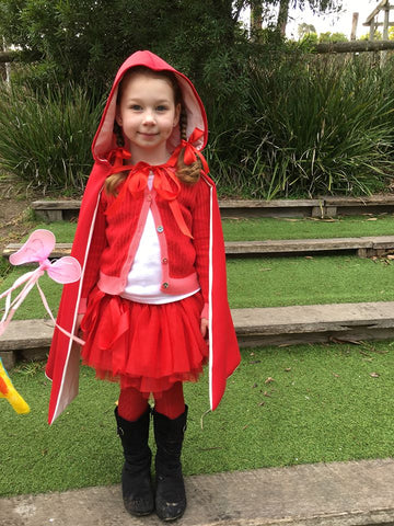 Girl dressed up a red riding hood