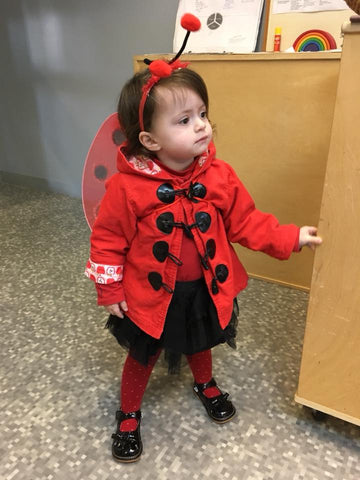 Little girl dressed up as a ladybug