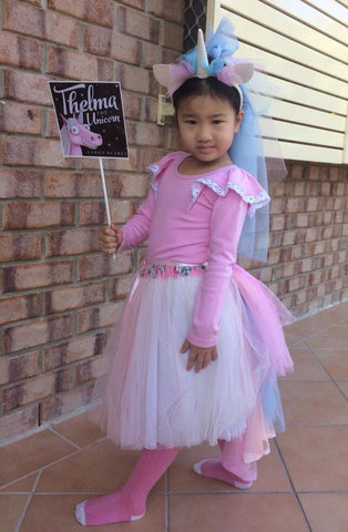 Girl in a pink top and tulle skirt
