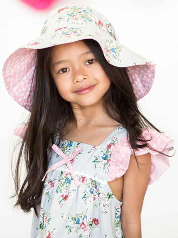 Girl in a blue floral hat