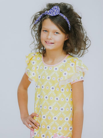 Girl in a yellow flower dress