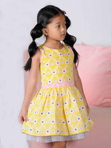 Girl in a yellow flower dresss