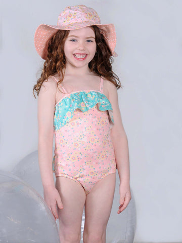 Girl in pink flower swimsuit