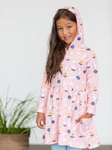 Girl in pink hoodie dress