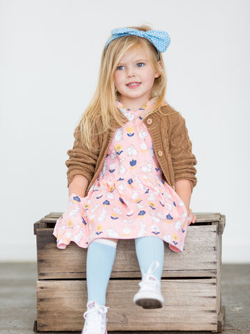 Girl in pink bunny dress and brown cardigan
