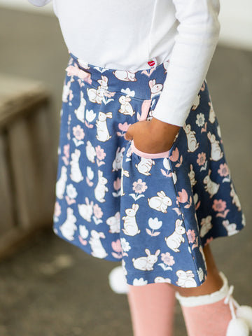 Girl in blue bunny skirt
