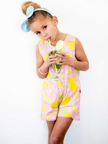 Girl in pink lemon playsuit