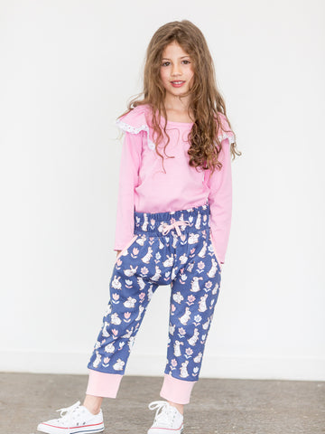 Girl in blue bunny pants