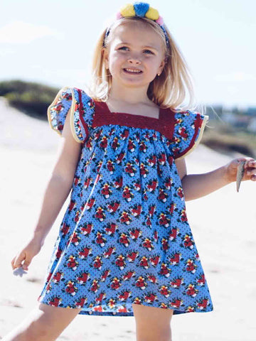 Girl in blue flower dress