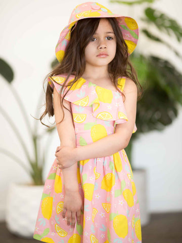 Girl in pink lemon dress