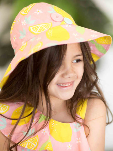 Girl in pink lemon hat